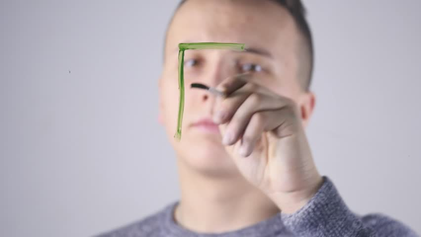 Close-up of a Man writes on a Glass Whiteboard | Shutterstock HD Video #1007708836