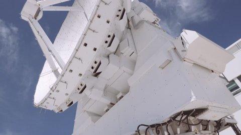 SAN PEDRO DE ATACAMA, CHILE - DECEMBER 3th 2017: Radio telescope antenna in maintenance at the ALMA control center, during a free visit to the ALMA building.