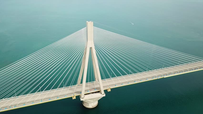 Aerial drone bird's eye view video of world's second longest cable-stayed Suspension bridge crossing Corinth Gulf, Greece