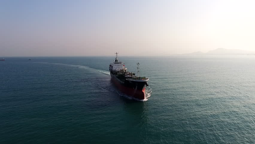 Aerial shot of cargo ship floating in sea