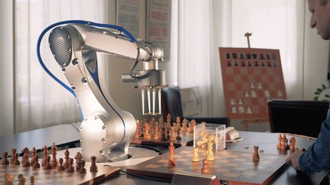 Robotic hand playing chess. Artificial intelligence concept. 4K.