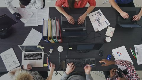 Timelapse of people working efficiently in a contemporary workplace. Entrepreneurs developing their small business in the shared office space.