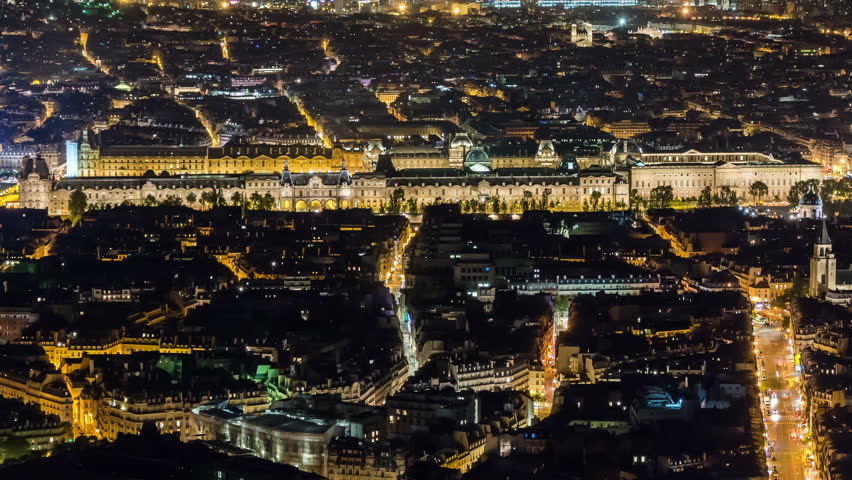 Paris city panorama at night. Louvre museum. Aerial view. City lights and streets with car traffic. Easy zoom out. | Shutterstock HD Video #1007850961