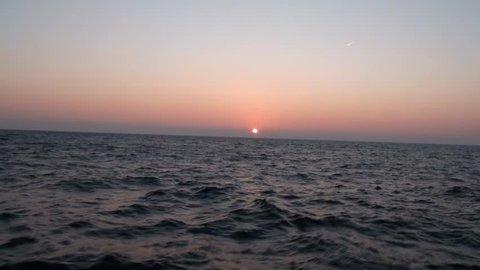 Sunrise at the ocean filmed from motor yacht