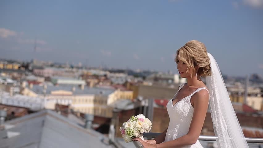 Blonde bride at the roof top in a city | Shutterstock HD Video #1007874691