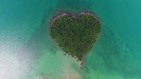 AERIAL. Top view from the dron to the paradise heart shape island. Thailand, Krabi