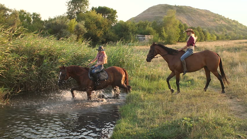 Two Girls Riding On Horses Bathe The In Lake A Background Of Reeds