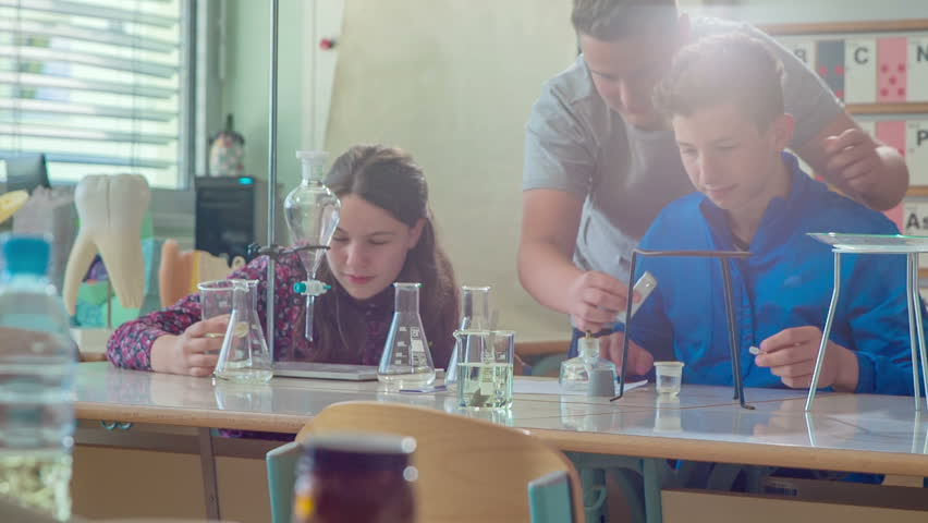 GRIZE/CELJE, SLOVENIA - 10. JUNE 2017 Students are busy conducting an experiment. They're having a Chemistry class. | Shutterstock HD Video #1007932321