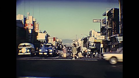 San Francisco, United States - in 1980: Restored archival footage in the 1980s of the red cable car in San Francisco California street with Bay bridge in the background.
