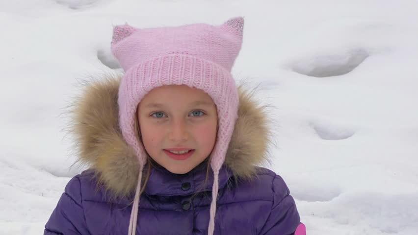 Portrait talking girl in snowy forest during winter walking close up   Shutterstock HD Video #1007987491