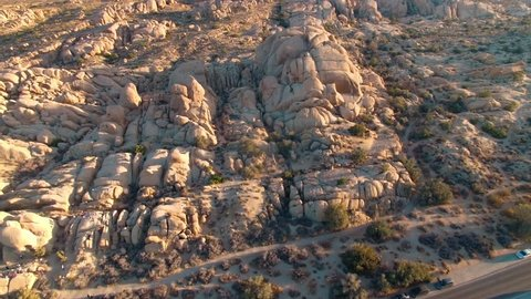Aerial panorama across rock formations in Joshua Tree National Park at sunset