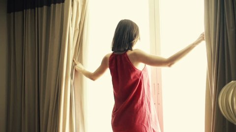 Woman unveil curtains in room, super slow motion, 240fps