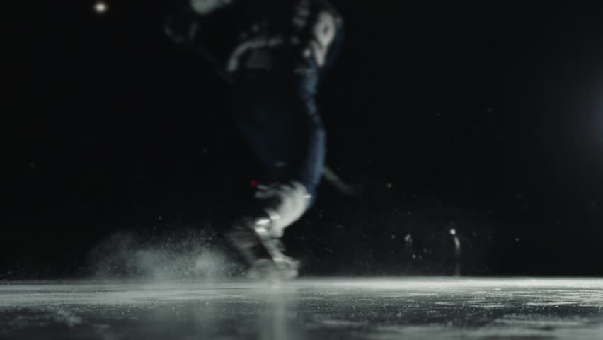 Ice Hockey player performing slap shot isolated on black background close up | Shutterstock HD Video #1008048271
