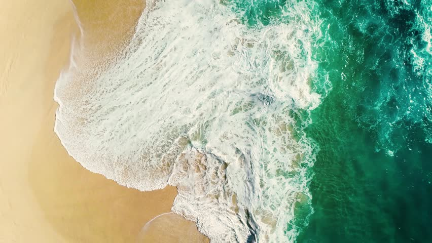 Aerial view waves break on white sand beach. Sea waves on the beautiful beach. drone 4k shot. zoom in | Shutterstock HD Video #1008056791