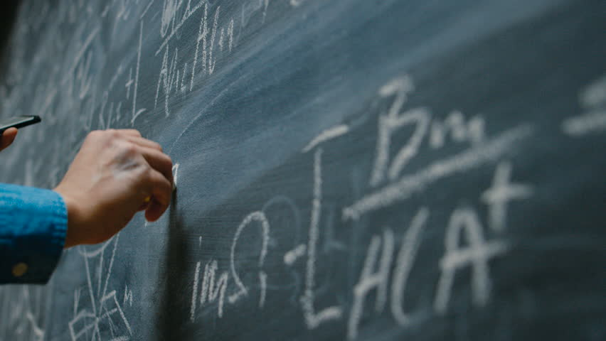 Hand Holding Chalk and Writing Complex and Sophisticated Mathematical Formula/ Equation on the Blackboard. Shot on RED EPIC-W 8K Helium Cinema Camera. | Shutterstock HD Video #1008065791