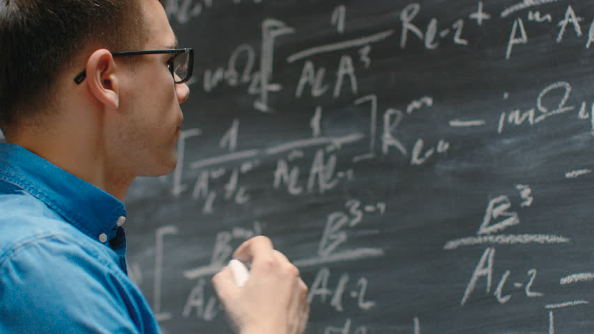 Brilliant Young Mathematician Writes Long and Complex Math Equation/ Formula on the Blackboard. Shot on RED EPIC-W 8K Helium Cinema Camera.