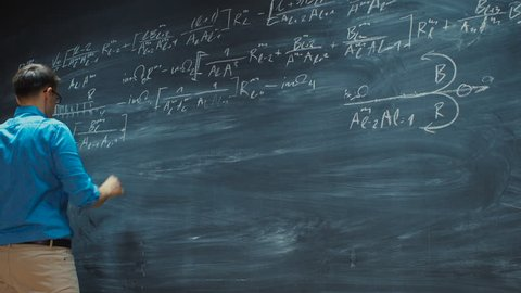 Time-Lapse of the Brilliant Young Mathematician Writing Formula on the Blackboard. Shot on RED EPIC-W 8K Helium Cinema Camera.