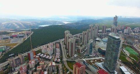 Aerial shot of deforestation. Aerial view of urbanization around Ankara city over forest areas.