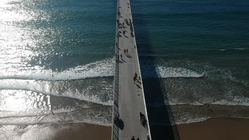A busy Hermosa Pier on California's coast