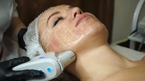 Non-surgical face lifting. Lubrication lifting ultrasonic. Facelift. Process of rejuvenation. Spa treatment. Hardware cosmetology. Treatment of facial skin by ultrasound.
