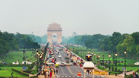 Delhi, India. Time-lapse of Car and people traffic to the India Gate in Delhi in the evening