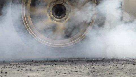 Drag racing car burn tire at start line