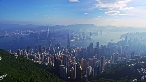 Incredible drone aerial cityscape panorama flight over urban architecture Hong Kong city in blue sky morning sunshine