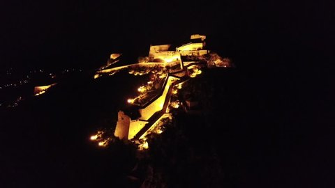 Aerial drone night video from picturesque and famous fortress of Palamidi in city of Nafplio former capital of Greece, Argolida, Peloponnese