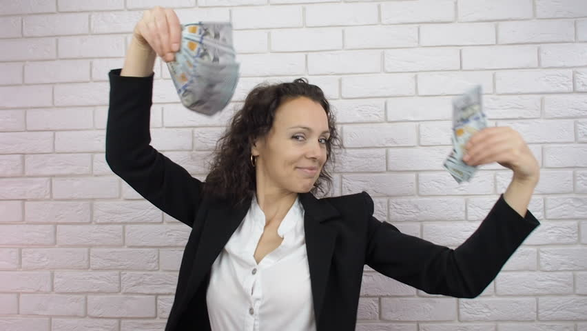 Happy woman with money. Business woman dancing with money.
