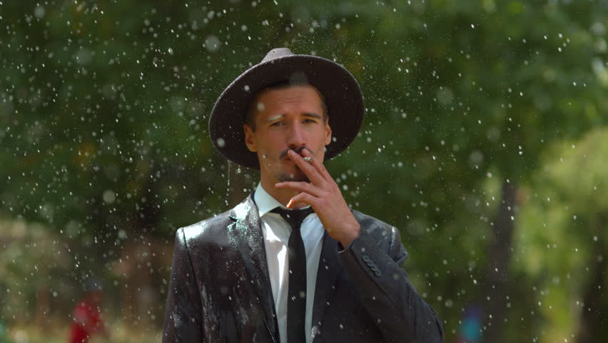 Man Smoking in the Rain, Stock Footage Video (100% Royalty-free) 1008223381  | Shutterstock