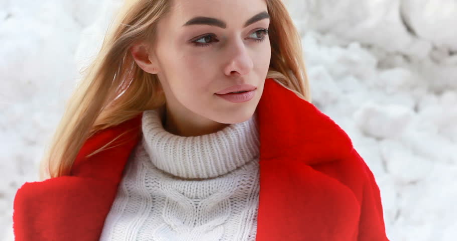 Winter, fashion, people concept - fashion Portrait of a beautiful young woman walks around the city smiling red fur coat close-up | Shutterstock HD Video #1008229651