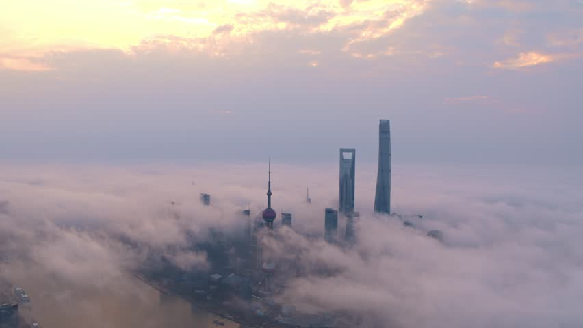 Aerial view of lujiazui,Shanghai skyline,skyscraper,advection fog.Drone footage. | Shutterstock HD Video #1008265951