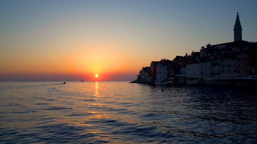 Sunset at Rovinj, Croatia - Panoramic view of old town of Rovinj in Istria, Croatia at beautiful sunset sky. Rovinj is a popular tourist resort, active fishing port and culture travel of Croatia.