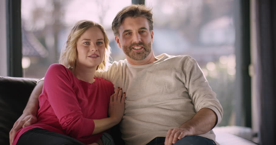 Couple on Sofa watching funny movie on Television | Shutterstock HD Video #1008373081