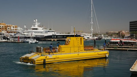 CABO SAN LUCAS, MEXICO - APRIL 22, 2017 - Yellow submarine semi-submersible boat takes tourists to see underwater reefs.