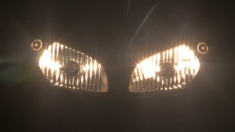 Close up view turned off headlight of sport motorcycle at night.4K