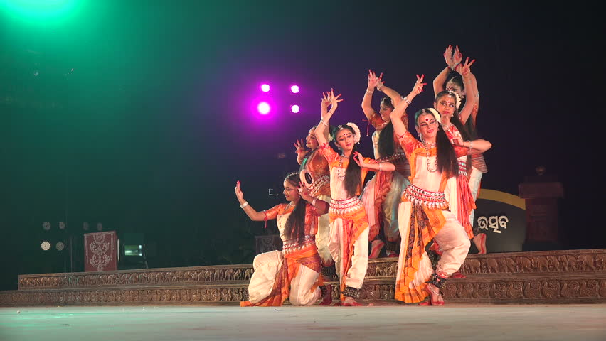 ODISHA, INDIA - DECEMBER 2014: An all girl Indian dance group takes on a classic pose during a traditional performance on stage in Konark