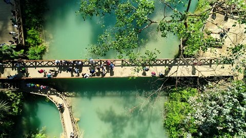 4k Video shot aerial view by drone. Kuang Si Waterfall Famous Landmark Nature Travel Place Of Luang Prabang City, Laos. Bird eye view landscape.