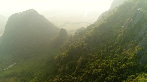 4k Video shot aerial view by drone. Pha Ngern View Point in Vang vieng, Laos. Landscape Mountain of Vang Vieng. sunrise