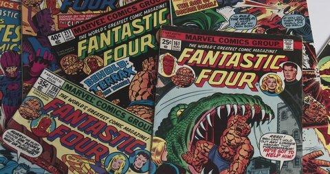 March 10, 2018, Bettendorf, Iowa,  Fantastic Four Comic Books - Placing Comic Book On Table