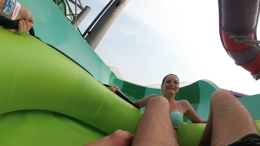 Water slides pov. The guy with the girl on the inflatable circle descends from the water slides. Chest Mount. Slow Motion