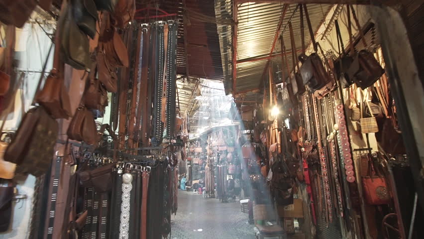 Flare and light rays in the souk of Marrakech Morocco where people sell typical and traditional home made commodities moving forward