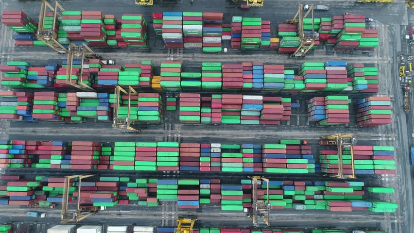 Video Container ship in export and import business and logistics. Shipping cargo to harbor by crane. Water transport International. Aerial view | Shutterstock HD Video #1008564391