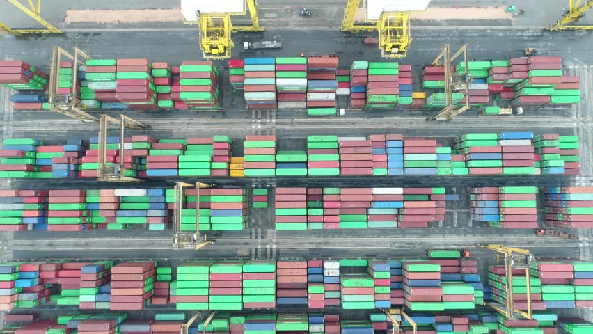 Video Container ship in export and import business and logistics. Shipping cargo to harbor by crane. Water transport International. Aerial view | Shutterstock HD Video #1008569431