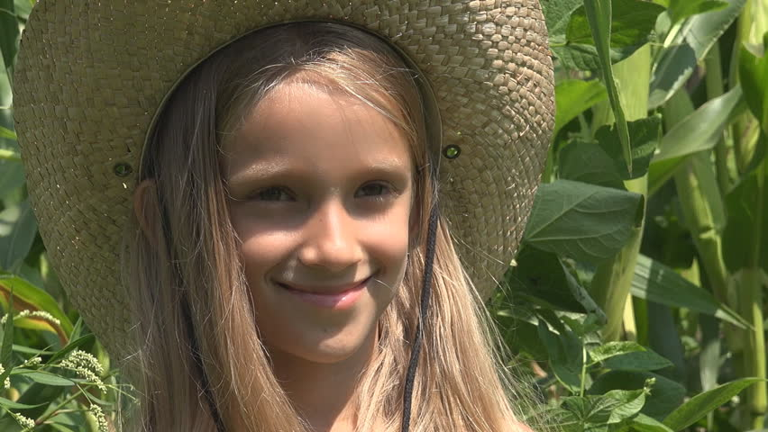 Farmer Child in Cornfield, Smiling Girl Face Outdoor in Agriculture Field | Shutterstock HD Video #1008598381