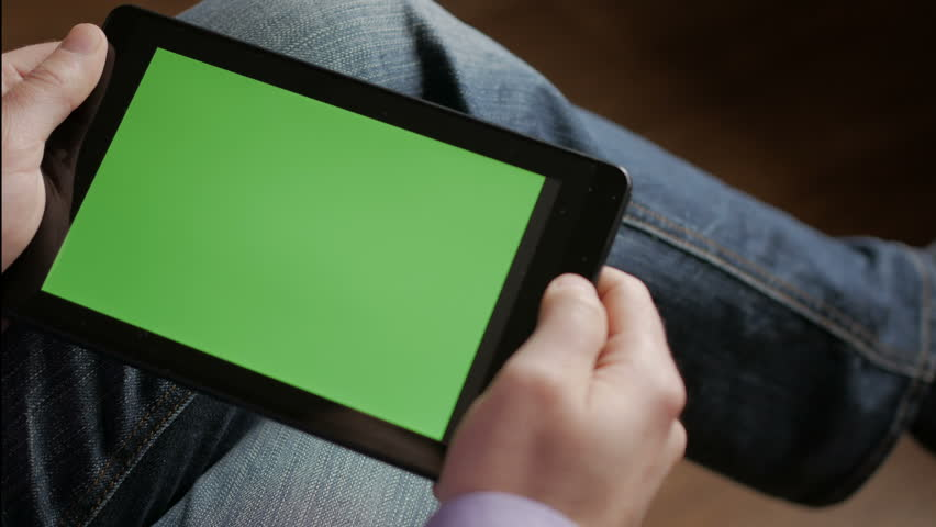 Man in the workplace using his tablet with green screen, scrolling news, checking financial reports, tapping on screen. Hands top view. 4K Hands holding business finance smart phone CHROME KEY | Shutterstock HD Video #1008609601