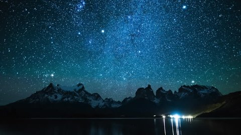 Torres del Paine National Park at night, timelapse from the coast of the lake Pehoe, Chile
