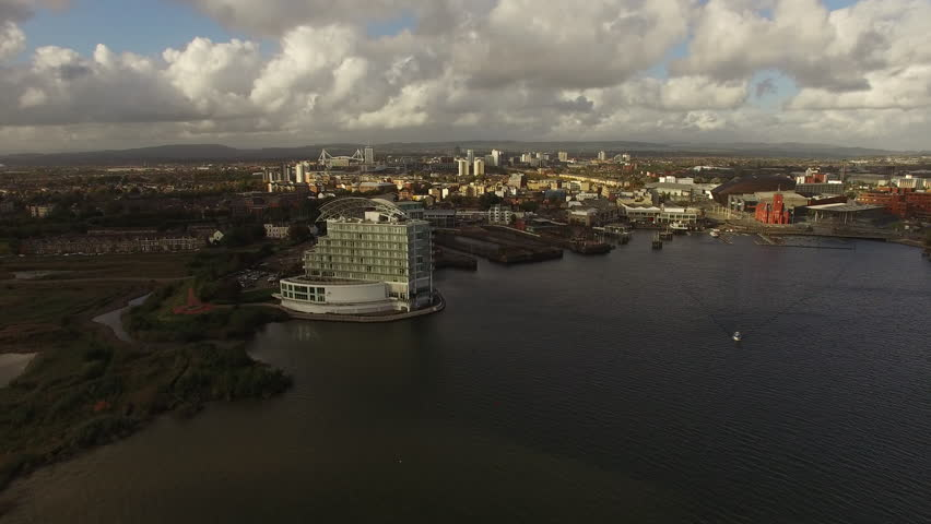 Cardiff bay Aerial, wide shot of water edge with Cardiff Millennium Stadium and surrandings