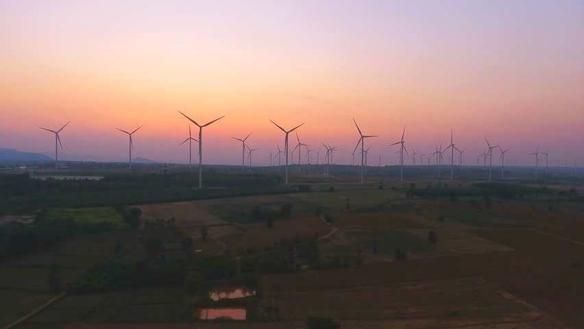 View from flying drone Large Wind Turbines at sunrise are one of the cleanest, renewable electric energy source.  | Shutterstock HD Video #1008638401