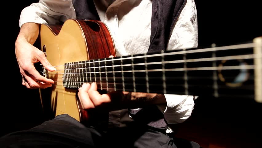 Man playing Acoustic guitar music musical musician flamenco band jazz Spain | Shutterstock HD Video #1008655651
